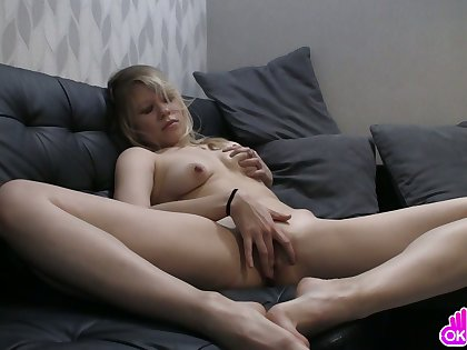 Beautiful young blonde fingers herself