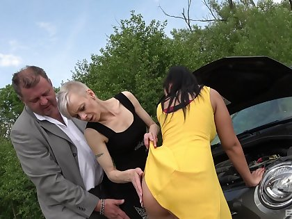 Mature lady and a horny girl love to blow outside for the best pleasure