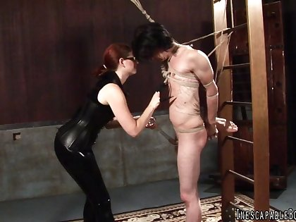 Redhead Mistress ties up her male sub in Japanese style bondage