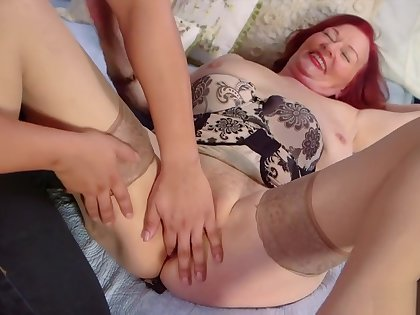 Redhead granny Katherine fucks young cock in her soft pussy
