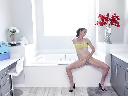 Slim doll pleases herself with soft pussy fingering